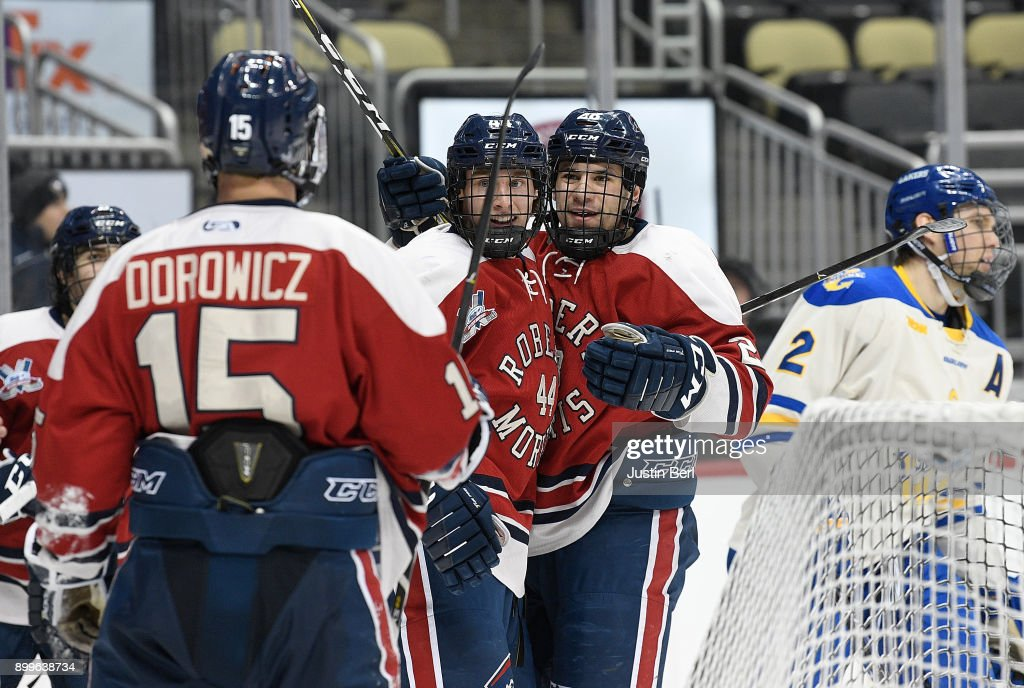 Luke Lynch #28 of the Robert Morris Colonials celebrates with teammates after scoring a goal in the second period during the game against the Lake Superior Lakers at PPG PAINTS Arena on December 29, 2017 in Pittsburgh, Pennsylvania.