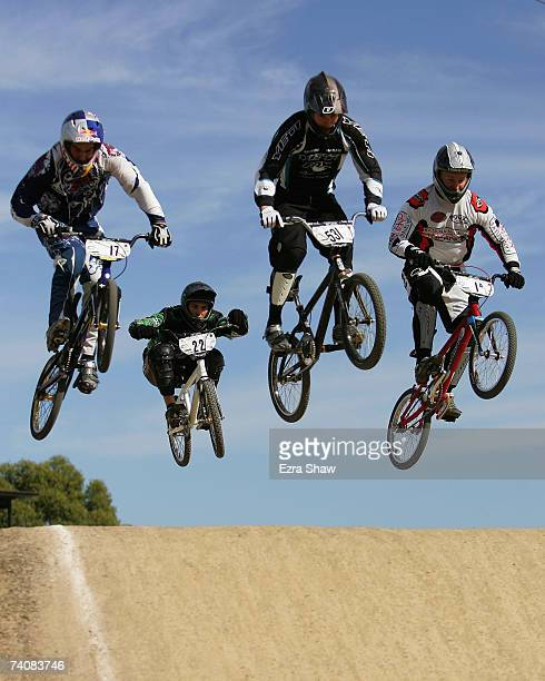 Luke Madill Daniel Johnstone Jared Graves and Kamakazi go over a jump in the men's elite category during the Australian National BMX Championships at...