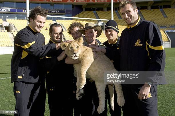 Luke Mahoney Luke Andrews Shannon Paku Ross Kenerdy and Ben Herring of the Wellington Lions stand with Lion Man Craig Busch and pose with Tshaka a...