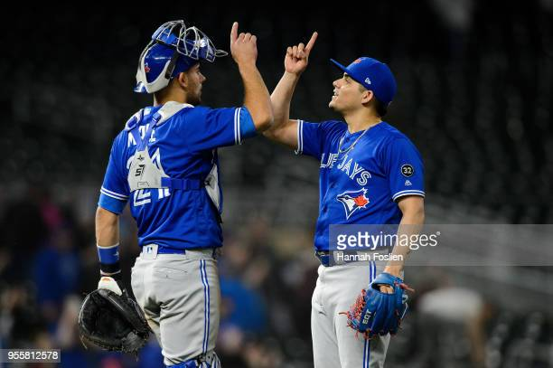 Luke Maile and Roberto Osuna of the Toronto Blue Jays celebrate winning against the Minnesota Twins after the game on May 1 2018 at Target Field in...