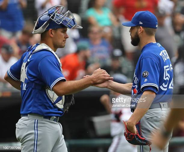 Luke Maile and Ryan Tepera of the Toronto Blue Jays celebrate a win over the Chicago White Sox at Guaranteed Rate Field on July 29 2018 in Chicago...