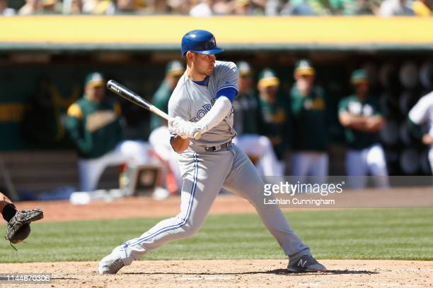 Luke Maile of the Toronto Blue Jays at bat in the top of the fifth inning against the Oakland Athletics at OaklandAlameda County Coliseum on April 20...
