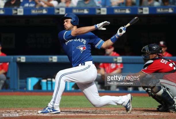 Luke Maile of the Toronto Blue Jays bats in the fifth inning during MLB game action against the Washington Nationals at Rogers Centre on June 16 2018...