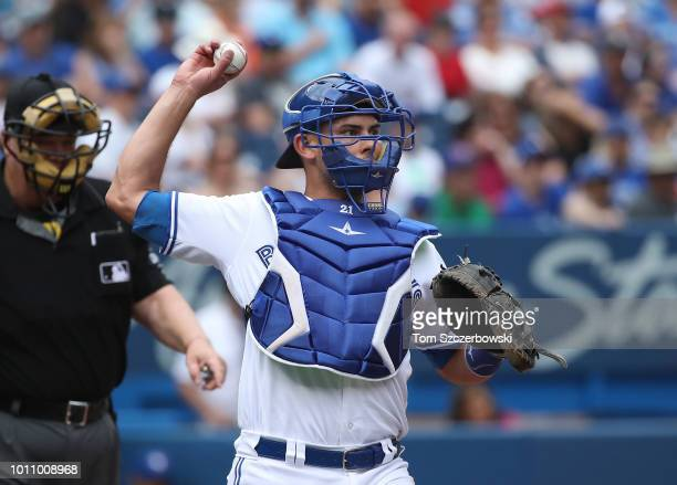 Luke Maile of the Toronto Blue Jays completes the strikeout as he throws the ball to first base to get Joey Rickard of the Baltimore Orioles in the...