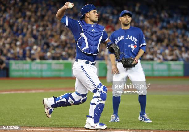 Luke Maile of the Toronto Blue Jays fields a soft grounder up the first base line and throws out the baserunner in the sixth inning during MLB game...