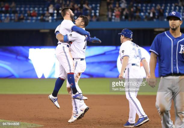 Luke Maile of the Toronto Blue Jays is congratulated on his gamewinning RBI single by Kevin Pillar and teammates in the tenth inning during MLB game...