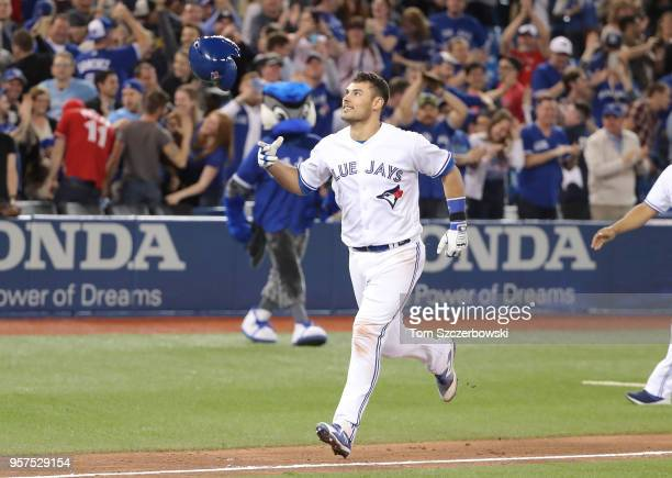 Luke Maile of the Toronto Blue Jays is tosses his helmet after hitting a gamewinning tworun home run in the twelfth inning during MLB game action...
