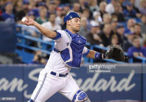 Luke Maile of the Toronto Blue Jays makes a threebase throwing error in the fourth inning during MLB game action against the Boston Red Sox at Rogers...