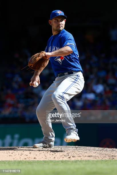 Luke Maile of the Toronto Blue Jays throws against the Texas Rangers during the eighth inning at Globe Life Park in Arlington on May 5 2019 in...