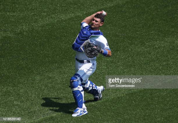 Luke Maile of the Toronto Blue Jays warms up in the outfield before the start of MLB game action against the Tampa Bay Rays at Rogers Centre on...