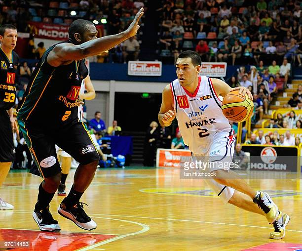 Luke Martin of the Hawks drives past Rolan Roberts of the Crocodiles during game two of the NBL semi final series between the Townsville Crocodiles...