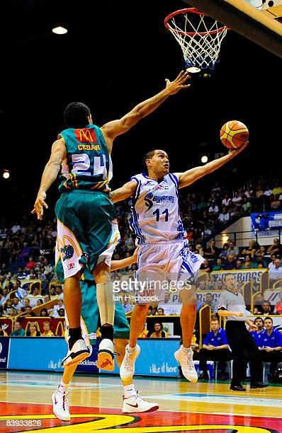 Luke Martin of the Spirit makes a layup despite the defence of Michael Cedar of the Crocodiles in action during the round 12 NBL match between the...