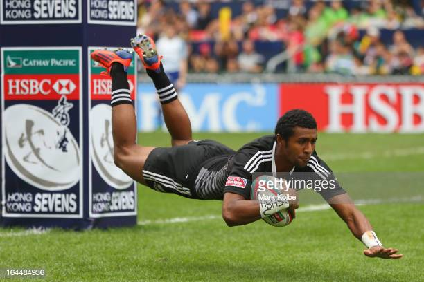 Luke Masirewa of New Zealand dives over to score as try during the cup quarter final match between New Zealand and Samoa day three of the 2013 Hong...
