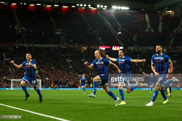 Luke Matheson of Rochdale celebrates after scoring a goal to make it 1-1 during the Carabao Cup Third Round match between Manchester United and...