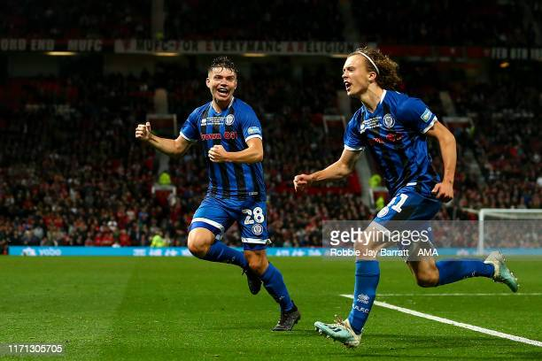 Luke Matheson of Rochdale celebrates after scoring a goal to make it 11 during the Carabao Cup Third Round match between Manchester United and...