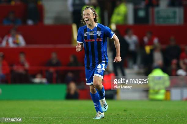 Luke Matheson of Rochdale celebrates scoring his teams first goal of the game during the Carabao Cup Third Round match between Manchester United and...