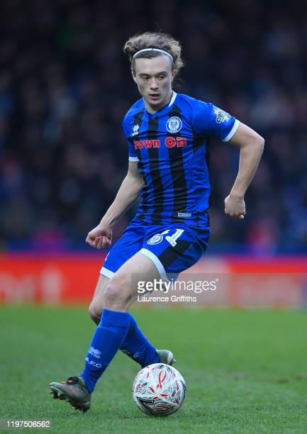 Luke Matheson of Rochdale runs with the ball during the FA Cup Third Round match between Rochdale AFC and Newcastle Untied at Spotland Stadium on...