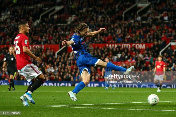 Luke Matheson of Rochdale scores a goal to make it 1-1 during the Carabao Cup Third Round match between Manchester United and Rochdale AFC at Old...
