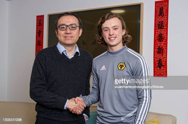 Luke Matheson of Wolverhamptoin Wanderers poses with Jeff Shi Chairman of Wolverhampton Wanderers following his signing for the club on January 31...
