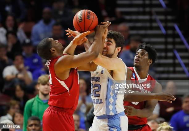 Luke Maye of the North Carolina Tar Heels battles for the ball with Manuale Watkins and Jaylen Barford of the Arkansas Razorbacks in the first half...