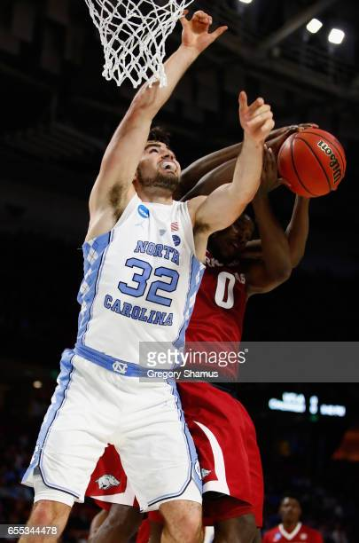 Luke Maye of the North Carolina Tar Heels battles for the ball with Jaylen Barford of the Arkansas Razorbacks in the first half during the second...