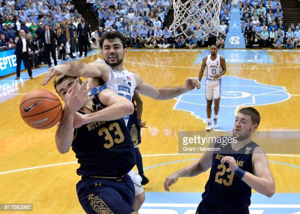 Luke Maye of the North Carolina Tar Heels battles John Mooney of the Notre Dame Fighting Irish for a rebound during their game at the Dean Smith...
