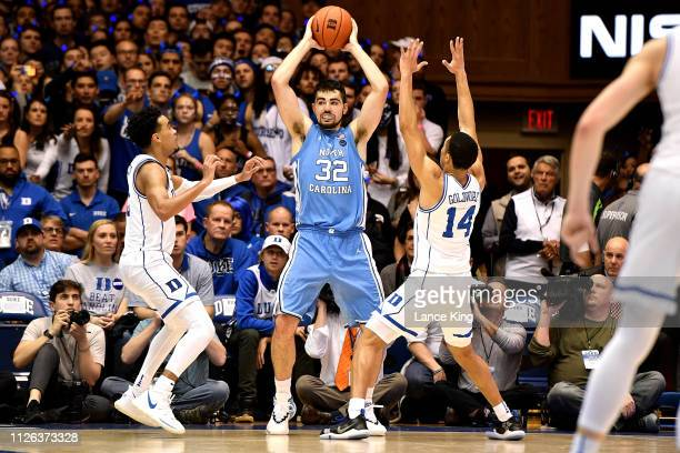 Luke Maye of the North Carolina Tar Heels controls the ball against Tre Jones and Jordan Goldwire of the Duke Blue Devils in the second half at...