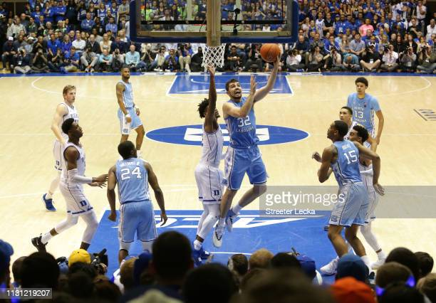 Luke Maye of the North Carolina Tar Heels drives to the basket against Cam Reddish of the Duke Blue Devils during their game at Cameron Indoor...