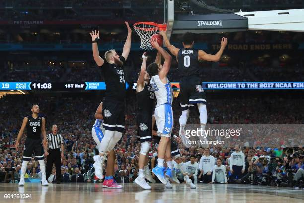 Luke Maye of the North Carolina Tar Heels shoots against Przemek Karnowski and Silas Melson of the Gonzaga Bulldogs in the first half during the 2017...