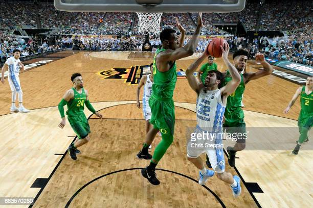 Luke Maye of the North Carolina Tar Heels Tyler Dorsey of the Oregon Ducks defends against during the 2017 NCAA Men's Final Four Semifinal at...