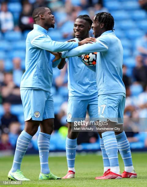 Luke Mbete, Romeo Lavia and Josh Wilson-Esbrand of Manchester City warm up during the Premier League match between Manchester City and Southampton at...