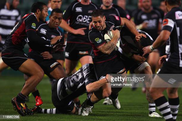 Luke McAlister of North Harbour tries to make a break during the round five ITM Cup match between North Harbour and Hawke's Bay at North Harbour...