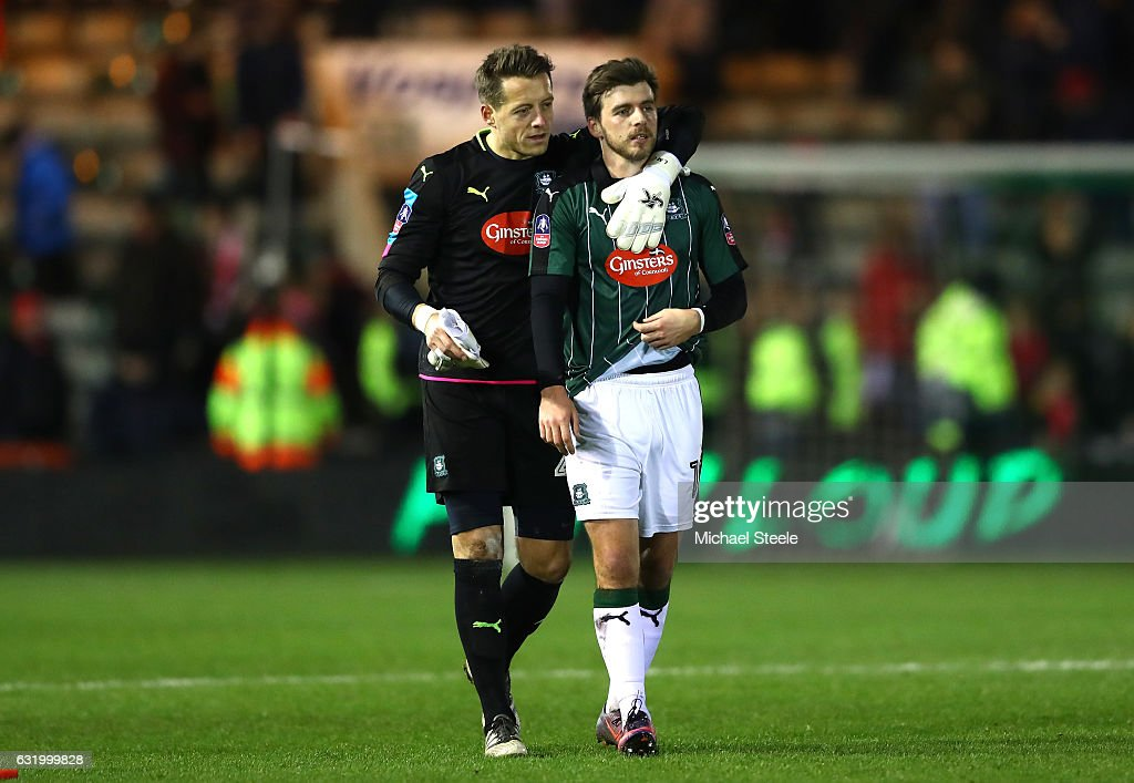 Luke McCormick of Plymouth Argyle and Graham Carey of Plymouth Argyle applaud supporters following defeat in The Emirates FA Cup Third Round Replay match between Plymouth Argyle and Liverpool at Home Park on January 18, 2017 in Plymouth, England.