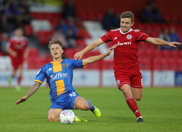 Luke McCormick of Shrewsbury Town and Sam Finley of Accrington Stanley during the Sky Bet League One match between Accrington Stanley and Shrewsbury...