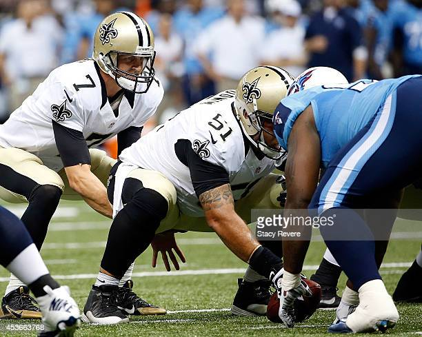 Luke McCown of the New Orleans Saints waits for the snap from Jonathan Goodwin during a preseason game against the Tennessee Titans at the...