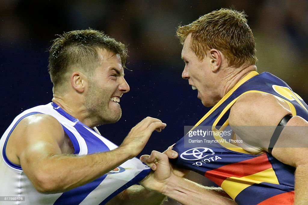 Luke McDonald of the Kangaroos and Tom Lynch of the Crows wrestle during the round one AFL match between the North Melbourne Kangaroos and the Adelaide Crows at Etihad Stadium on March 26, 2016 in Melbourne, Australia.