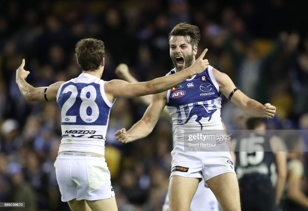 Luke McDonald of the Kangaroos celebrates after kicking a goal during the round 10 AFL match between the Carlton Blues and the North Melbourne Kangaroos at Etihad Stadium on May 28, 2017 in Melbourne, Australia.