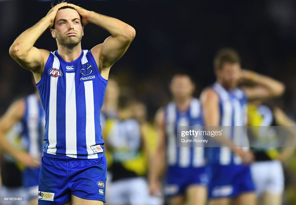 Luke McDonald of the Kangaroos looks dejected after losing the round 11 AFL match between the North Melbourne Kangaroos and the Richmond Tigers at Etihad Stadium on June 3, 2017 in Melbourne, Australia.