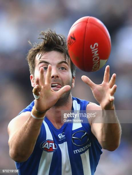 Luke McDonald of the Kangaroos marks during the round 12 AFL match between the Geelong Cats and the North Melbourne Kangaroos at GMHBA Stadium on...