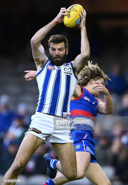 Luke McDonald of the Kangaroos marks infront of Cody Weightman of the Bulldogs during the round 16 AFL match between Western Bulldogs and North...