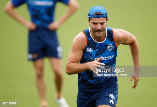 Luke McDonald of the Kangaroos runs the yoyo test during the North Melbourne Kangaroos training session at Arden St on December 4 2017 in Melbourne...
