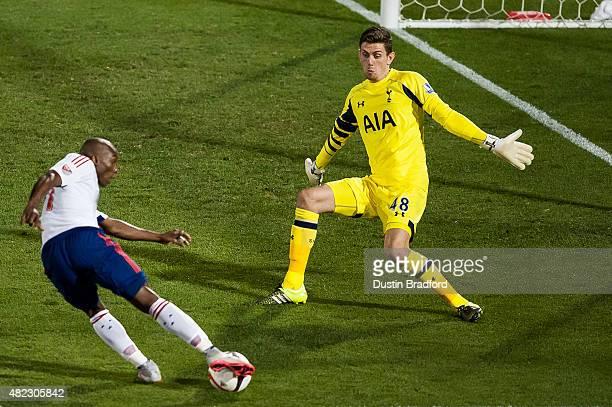 Luke McGee of Tottenham Hotspur defends against Fabian Castillo of MLS AllStars during the 2015 ATT Major League Soccer AllStar game at Dick's...