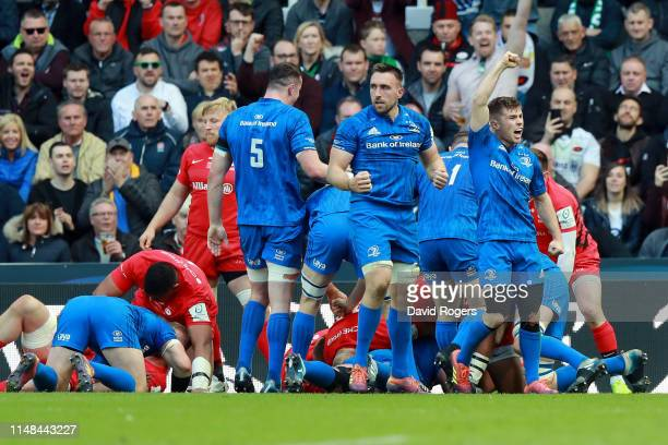 Luke McGrath of Leinster celebrates after Tadgh Furlong touches down for a try during the Champions Cup Final match between Saracens and Leinster at...