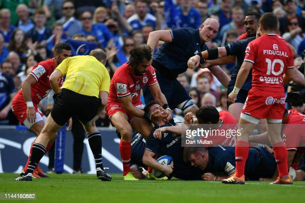 Luke McGrath of Leinster goes over to score his side's sexond try as he is tackled by Yoann Huget of Toulouse during the Heineken Champions Cup Semi...