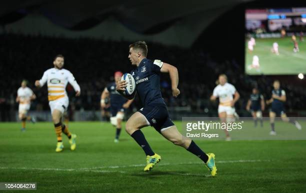 Luke McGrath of Leinster Rugby breaks through to score the fourth try during the Champions Cup match between Leinster Rugby and Wasps at RDS Arena on...