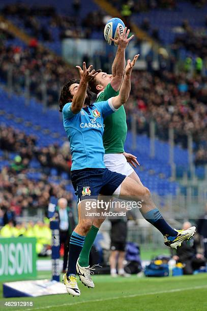 Luke McLean of Italy and Tommy Bowe of Ireland compete for the high ball during the RBS Six Nations match between Italy and Ireland at the Stadio...