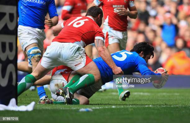 Luke McLean of Italy dives over to score a try during the RBS Six Nations Championship match between Wales and Italy at Millennium Stadium on March...