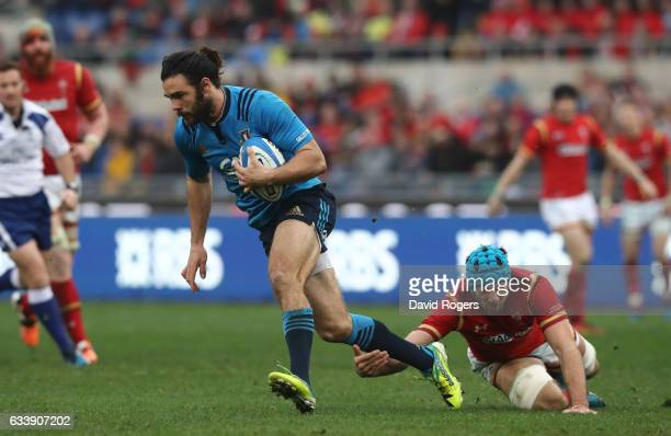 Luke McLean of Italy evades the tackle from Justin Tipuric of Wales during the RBS Six Nations match between Italy and Wales at the Stadio Olimpico...