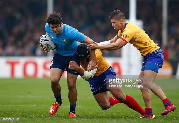 Luke McLean of Italy is closed dowen by Valentin Ursache and Valentin Calafeteanu of Romania during the 2015 Rugby World Cup Pool D match between...