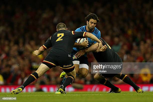 Luke McLean of Italy is tackled by Ken Owens and Gethin Jenkins of Wales during the International Match between Wales and Italy at Millennium Stadium...
